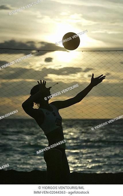 Women playing volleyball on beach. Loutraki, Corinthia, Peloponnese, Greece