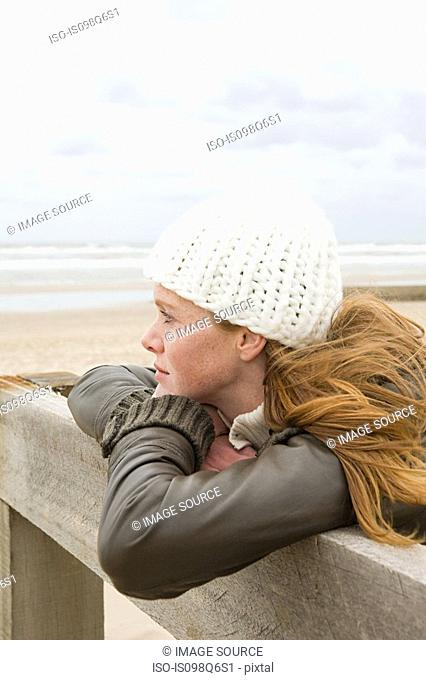 Thoughtful woman by the sea