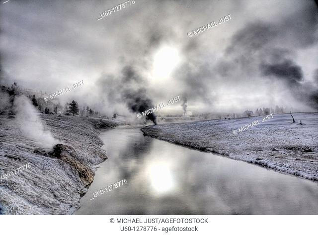 A cold winter morning produces frost and steam along the Firehole River at the Upper Geyser Basin at Yellowstone National Park, Wyoming
