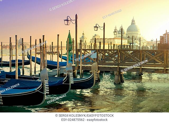 Gondolas and basilica Santa Maria della Salute in Venice, Italy