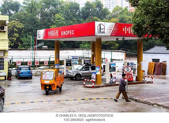Kaili, Guizhou, China. Small Gas Station near Town Center