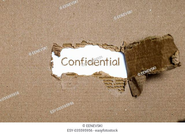 The word Confidential appearing behind torn paper
