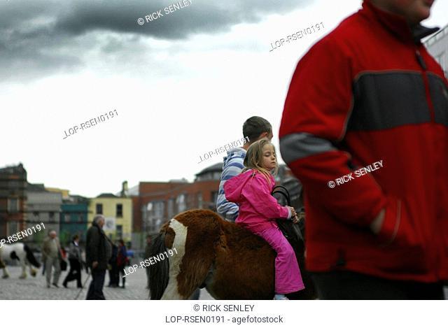 Republic of Ireland, Dublin, Smithfield Horse Market, Youngsters on horseback at Smithfield Horse Market in Dublin