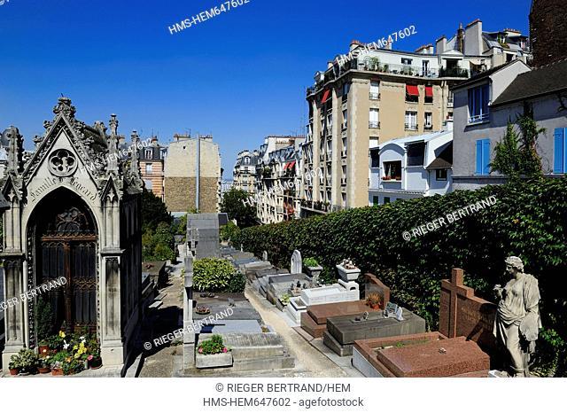 France, Paris, Butte Montmartre, Saint Vincent cemetery surrounded by buildings and the grave of the painter Utrillo