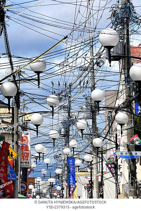 full of cables and street lamps street of Fushimi-ku, ward of Kyoto, Kansai Region, Japan