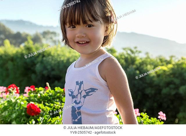 Three year old girl wearing a printed tank top, La Jolla, California