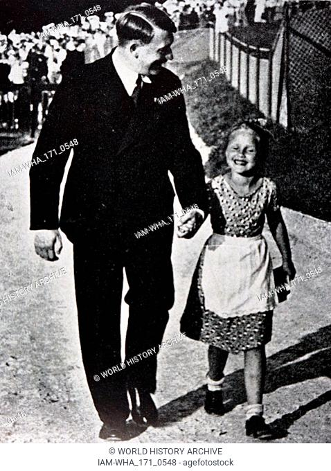 Adolf Hitler (1889 - 1945); German politician, demagogue. leader of the Nazi Party, with a typical Aryan child. Germany as Chancellor in 1933 and Fuhrer...