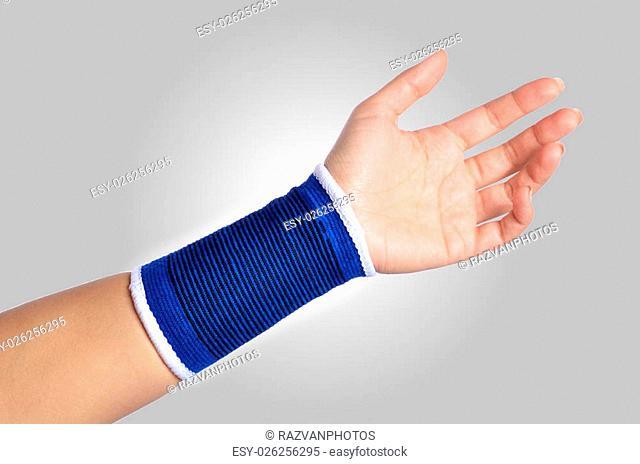 hand with a orthopedic wrist brace