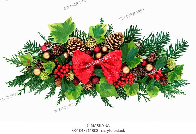 9c9683abb8cf Christmas decoration with red bow, bauble decorations, holly, ivy, gold  pine cones
