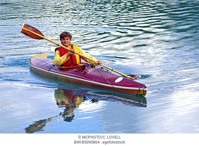 A young Kayaker enjoying the placid waters of Adams inlet, USA, Alaska, Glacier Bay National Park