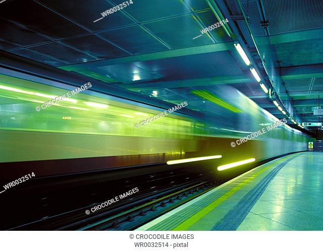 Blurred view of train leaving station