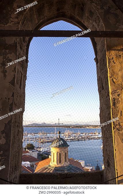 Aerial view of city against romantic skyline at sunset. Alghero, Sardinia. Italy