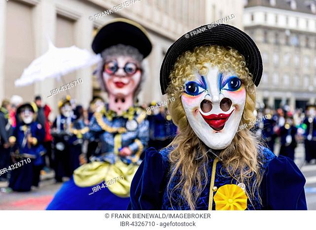 Portrait of a woman wearing a fancy dress and a mask at the great procession of the Carnival of Basel, Basler Fasnacht, Basel, Switzerland