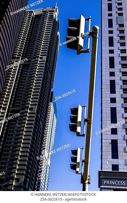 Traffic Lights in front of supertall skyscrapers at Dubai Marina, Dubai, UAE