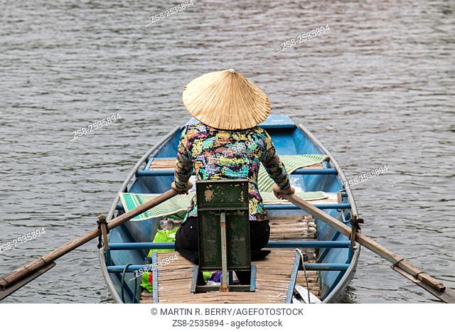 Vietnamese Lady Boat owner rowing her Boat at Tam Coc Ninh Binh, Vietnam