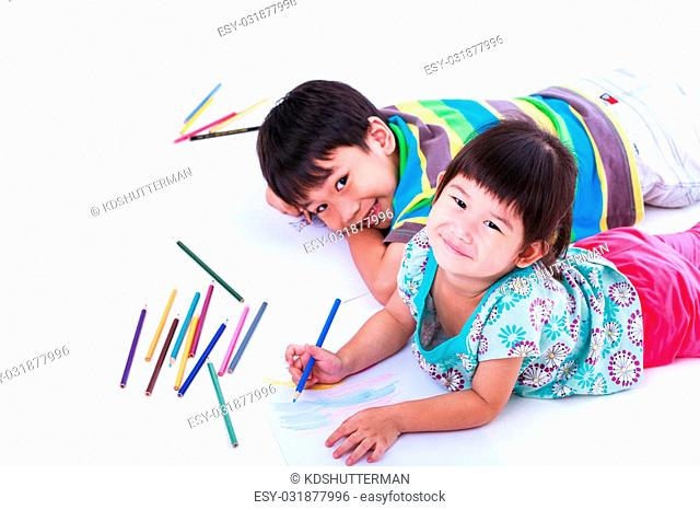 Asian (thai) sibling happily, brother and sister looking at the camera and smiling, on white background. Concepts of creativity and education