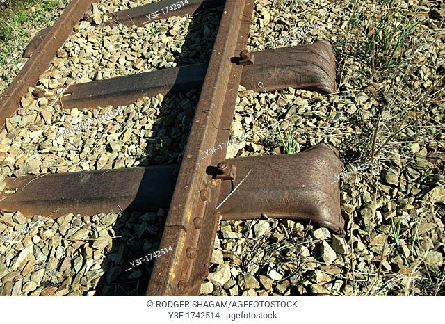 An historical piece of Victorian railway track, now abandoned, lies in disuse