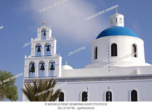 Blue domed Greek Orthodox church with steeple and bells in Oia Santorini Greece
