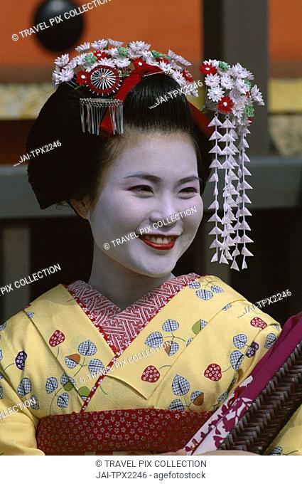 Apprentice Geisha (Maiko) / Woman Dressed in Traditional Costume / Kimono, Kyoto, Honshu, Japan