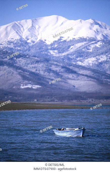 Boat at east banks of lake near Aghios Athanasios Lambero beach  North Agrafa at background, Lake Plastira, Thessaly, Greece