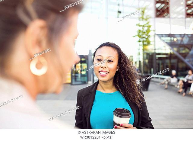 Businesswomen talking by central station
