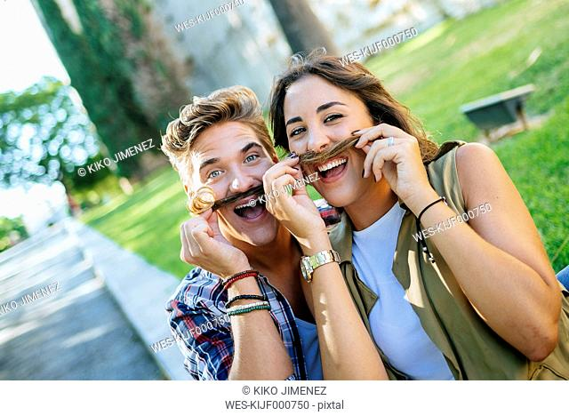 Young couple pulling funny faces