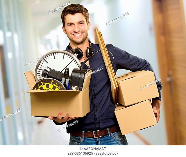 Happy Young Man Holding Cardboxes, Indoor