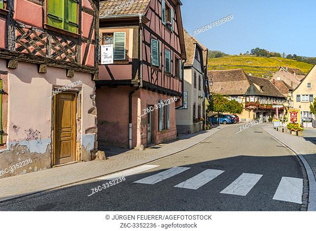 street in Andlau with view to vineyards above, Alsace, France