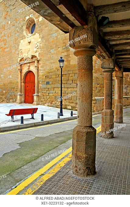 Church of Santa Maria and pillars of the porticoed square, Linyola, Lleida, Catalonia, Spain