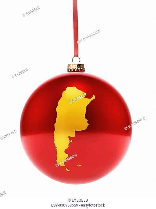A hanging glossy red bauble with the golden shape of Argentina.(series)