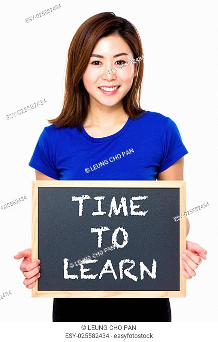 Asian woman hold with chalkboard and showing phrase of time to learn