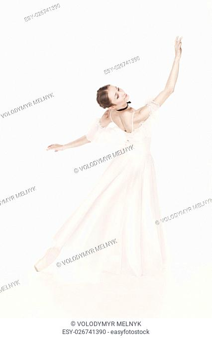 Portrait of the classical ballerina in white dress on white background