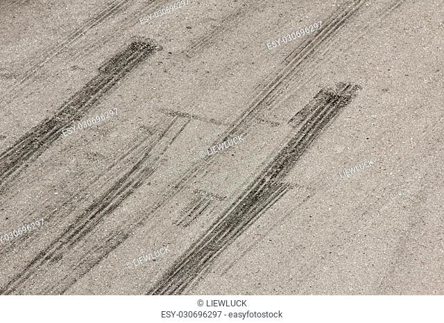 Background with tire marks on road track
