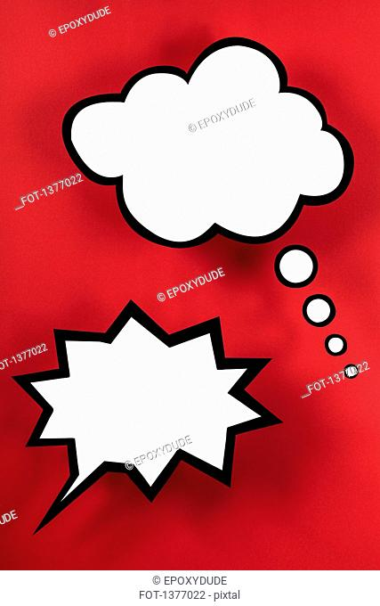 Empty speech bubbles against red background