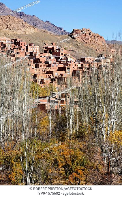 The village of Abyaneh beyond orchard trees, Iran
