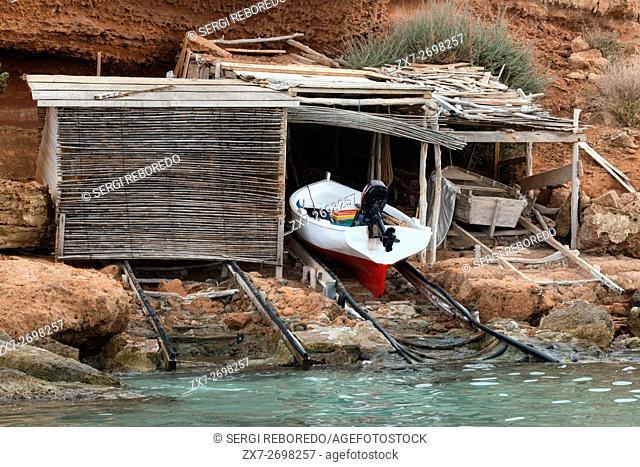 Traditional fishing boat in summer day. Llaüt boats. Cala Sahona, Formentera, Balearics Islands, Spain. Barbaria Cape