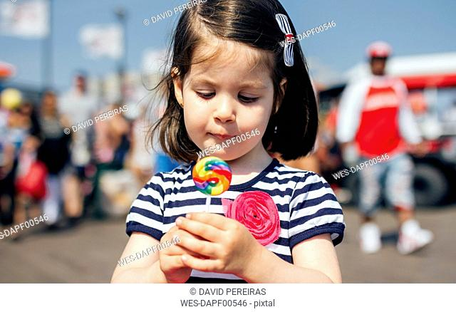 USA, New York, Coney Island, little girl with lollipop