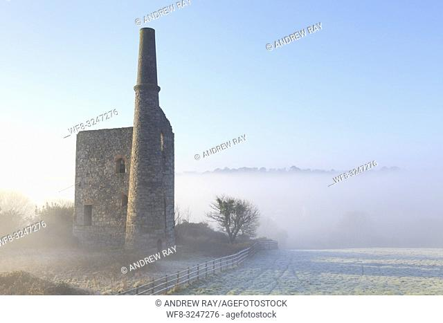 The entrance to the engine houses at Wheal Bush, near Crofthandy in mid Cornwall, captured on a frosty morning in late January with mist in the Poldice valley...