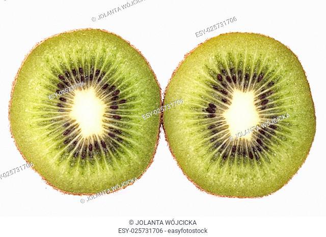 two slices of fresh green fruit of kiwi isolated on white background, close up
