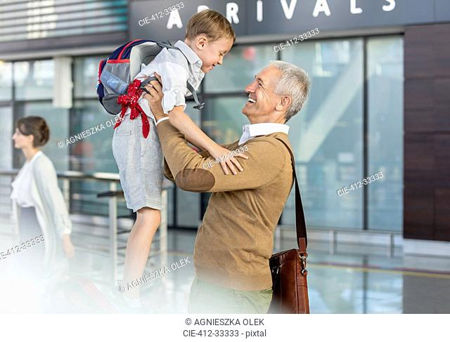 Son greeting father at airport