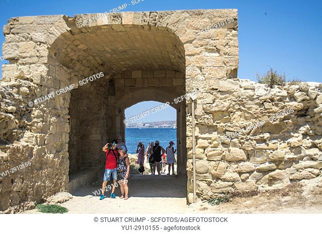 Couple take a selfie in the archway to one of the beaches on the island of Tabarca Spain