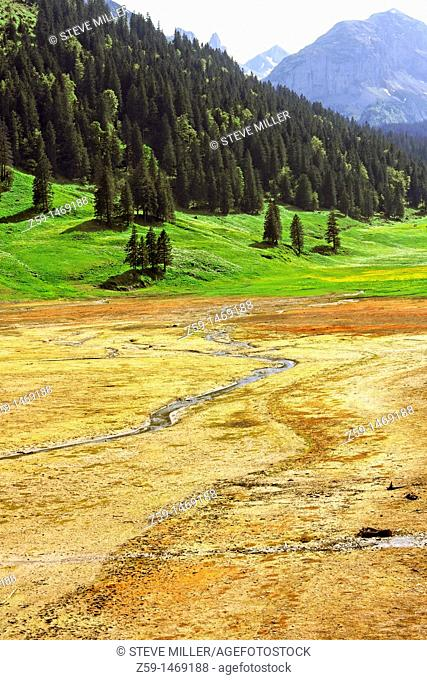 dry lake samtisersee after less precipitation in winter and spring - canton of appenzell-innerrhoden - switzerland