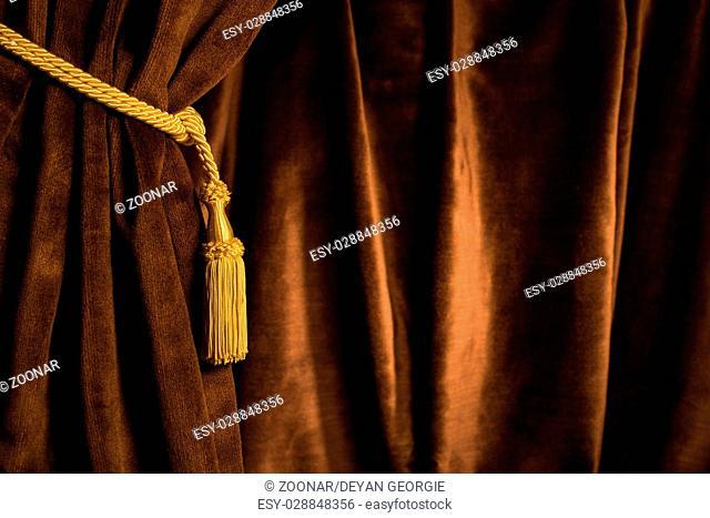 Brown theatre curtain