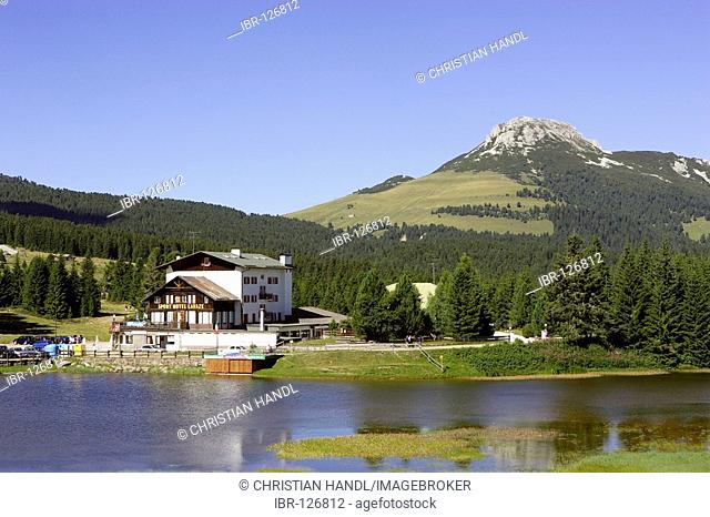 Hotel and lake and behind the Weißhorn (2316m), South Tyrol, Italy