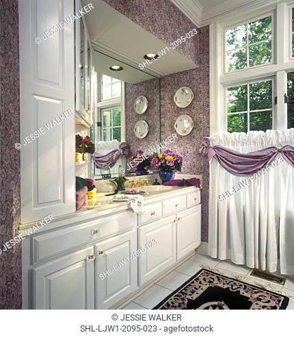 BATHROOM: lavendar Powder room with white cabinets, mirror wall, paisley print wallpaper