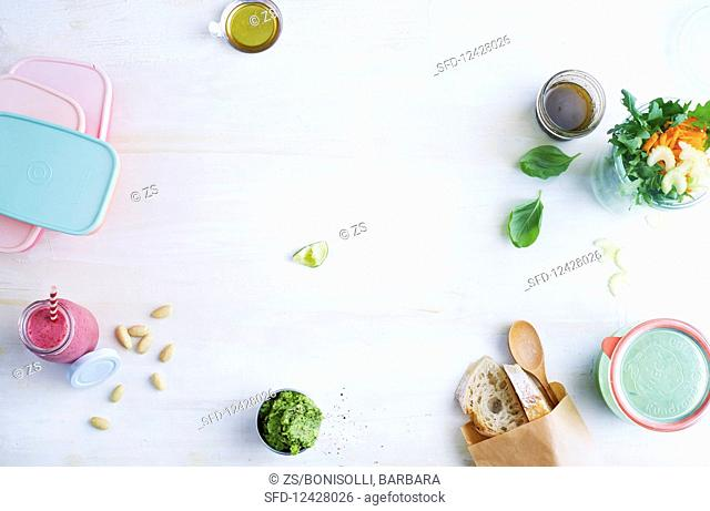 Salad, a vegetable spread and a smoothie