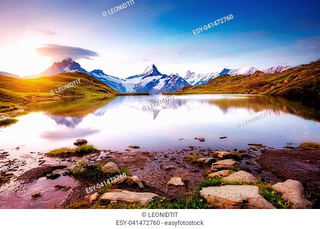 Alpine view of the Mt. Schreckhorn and Wetterhorn. Popular tourist attraction. Dramatic and picturesque scene. Location place Bachalpsee in Swiss alps