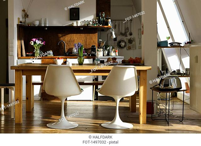 Chairs and table in modern kitchen at home