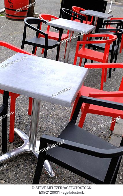 Colorful chairs and tables outside a restaurant
