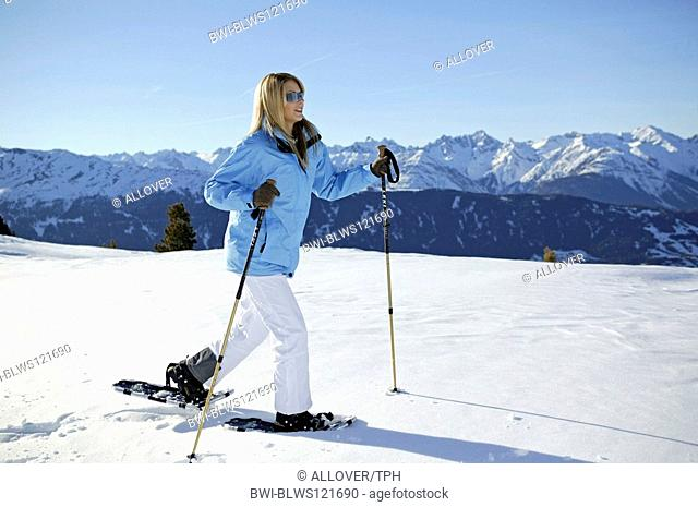 woman in winter, hiking with snow shoes